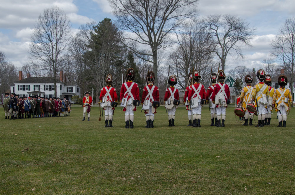 The Lexington Minute Men are confronted by British forces during the 2018 dress rehearsal of the Patriots Day reenactment. (Sharon Brody/WBUR)
