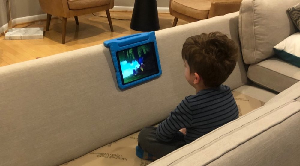 The author's son, Oliver, watches his tablet on the family's living room couch, which was in the process of becoming a fort. (Courtesy of Chloe I. Cooney)