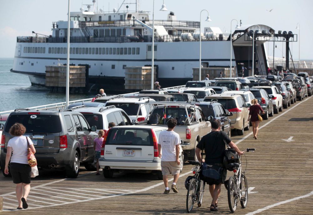 Passengers with cars and bicycles prepare to board a ferry departing the island of Martha's Vineyard, in Oak Bluffs, Mass. (Steven Senne/AP)