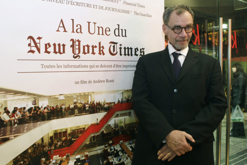 """New York Times journalist David Carr poses for a photograph as he arrives for the French premiere of the documentary """"Page One: A Year Inside The New York Times,"""" in Paris, Monday, Nov. 21, 2011. (Michel Euler/AP)"""