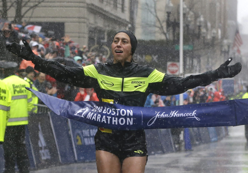 Desiree Linden crosses the finish line to win the women's division of the 122nd Boston Marathon on Monday, April 16, 2018, in Boston. Linden was the first American woman to win the race since 1985. (Elise Amendola/AP)