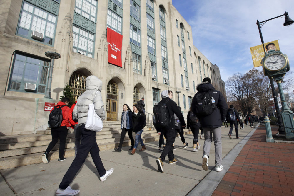 In this Thursday, Nov. 29, 2018, photo students and passers-by walk past an entrance to Boston University College of Arts and Sciences (Steven Senne/AP File Photo)
