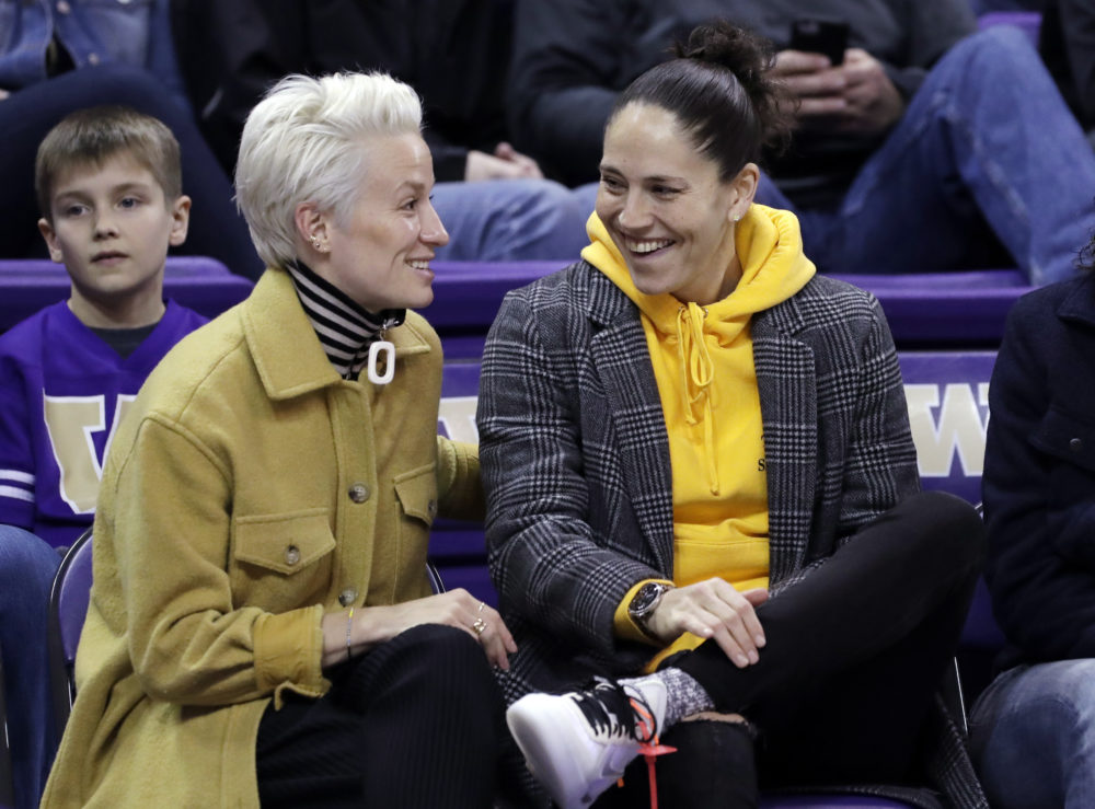 Don't worry, this is an archive photo! Megan Rapino (left) and Sue Bird (right) are safely at home during the pandemic. They joined Only A Game to talk about the especially poor timing of the current crisis for women's sports. (Elaine Thompson/AP)