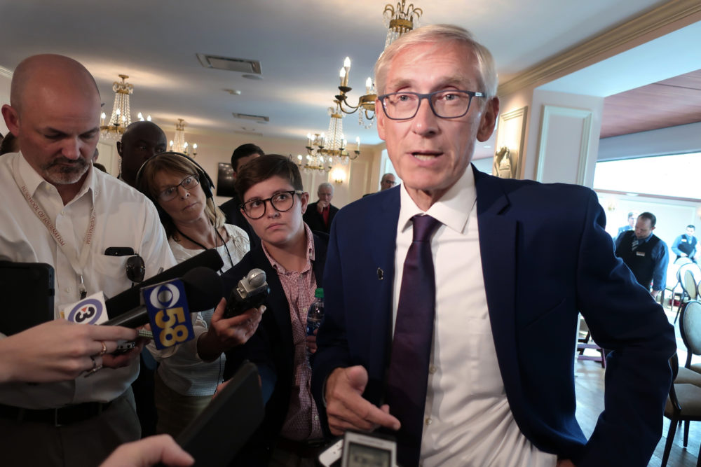 Wisconsin Gov. Tony Evers speaks with reporters at an event in Madison, Wis., last year. (Scott Bauer/AP)