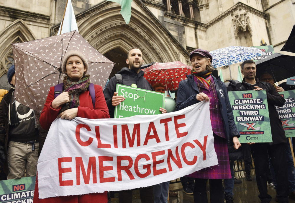 Some experts believe pandemics like the coronavirus are made worse as climate change effects increase. Climate change protesters demonstrate outside the Royal Courts of Justice in London back in February. (Stefan Rousseau/PA via AP)