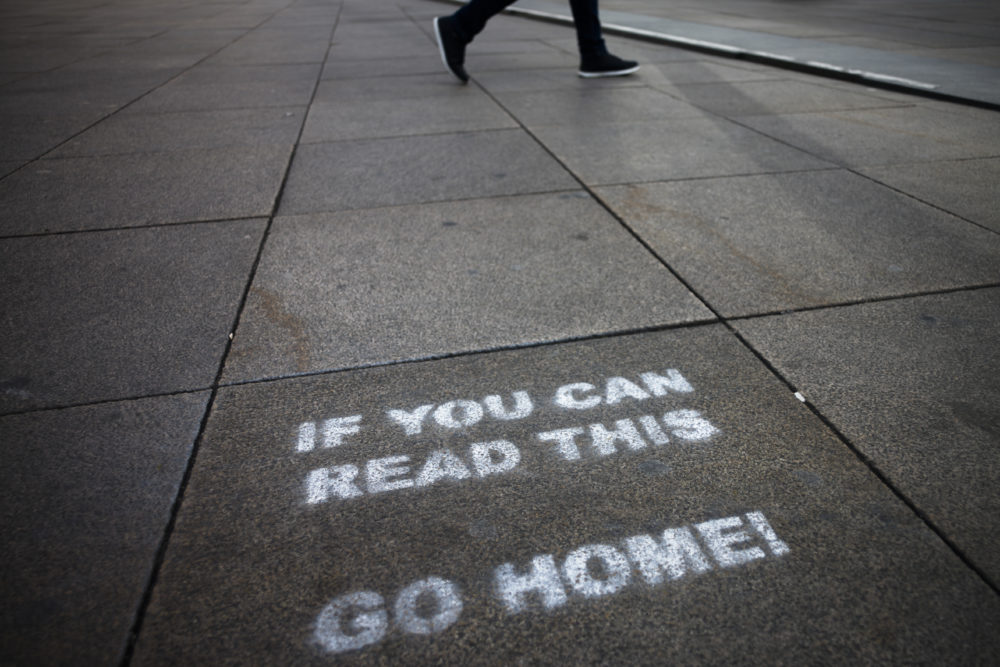In this March 30, 2020, file photo, a message demanding the people to go home is sprayed on the ground of Alexanderplatz square in Berlin, Germany. (Markus Schreiber/AP)