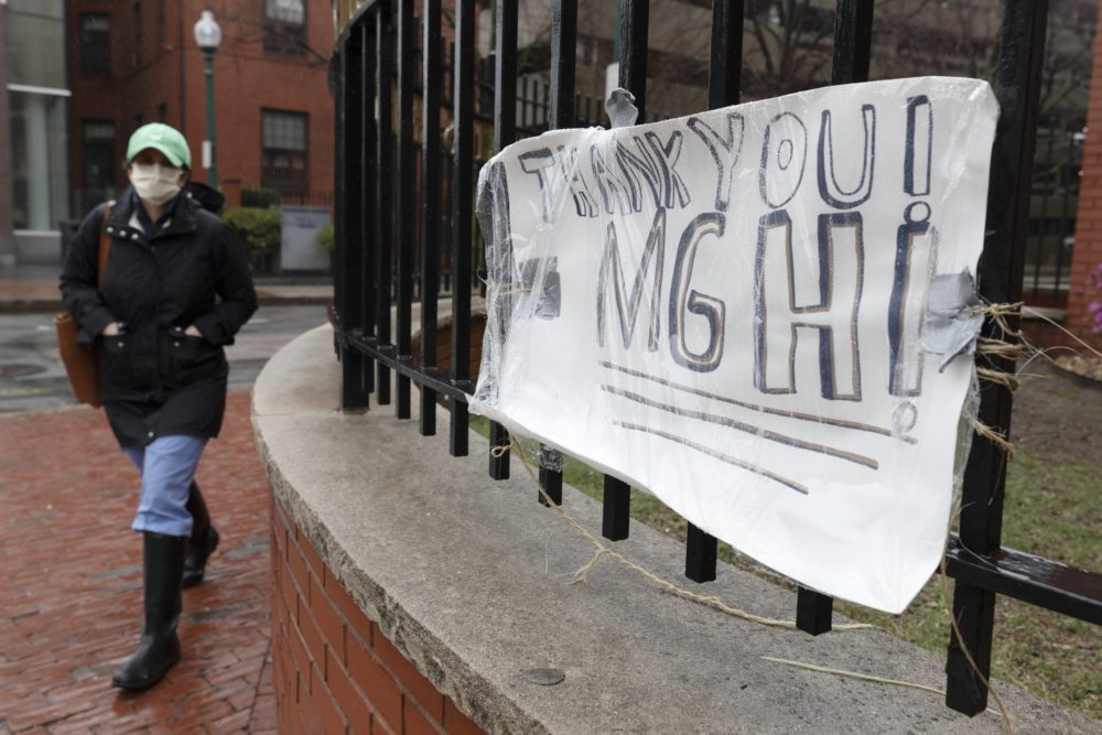 A make-shift sign posted outside Massachusetts General Hospital expresses thanks to MGH, Friday, April 3, 2020, in Boston. (Michael Dwyer/AP)