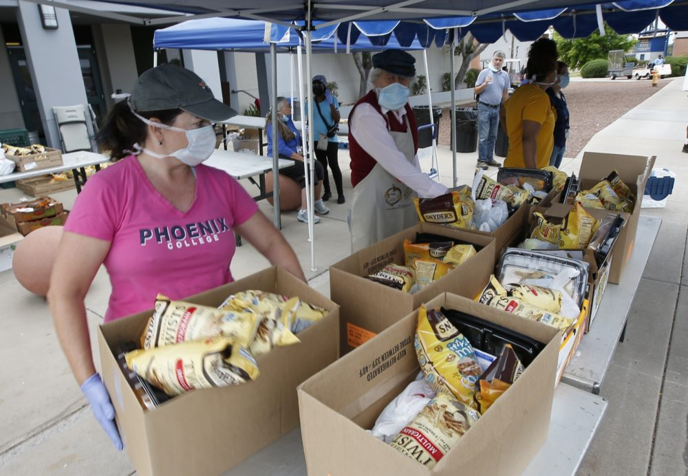 Food banks across the country are reporting a surge in demand from families impacted by the coronavirus pandemic. (Ross D. Franklin/AP)