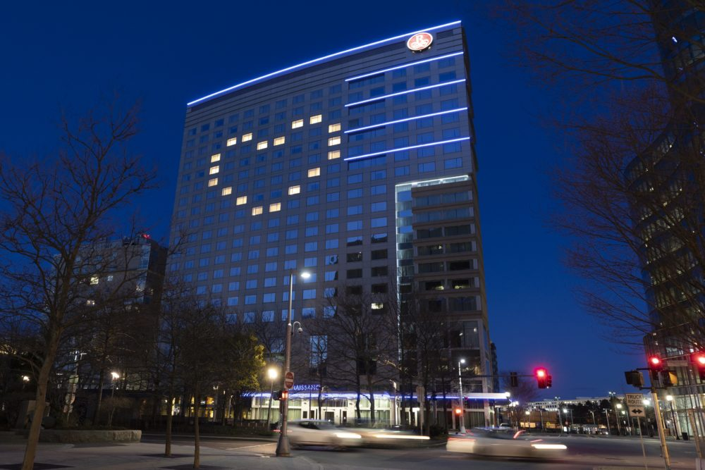 """As part of a campaign by the Greater Boston Convention and Visitors Bureau, hotels around Boston lit up their windows in heart shapes to show appreciation to those """"on the front lines"""" of the coronavirus response. Here, the Renaissance Boston Waterfront Hotel on April 11. (Michael Dwyer/AP)"""