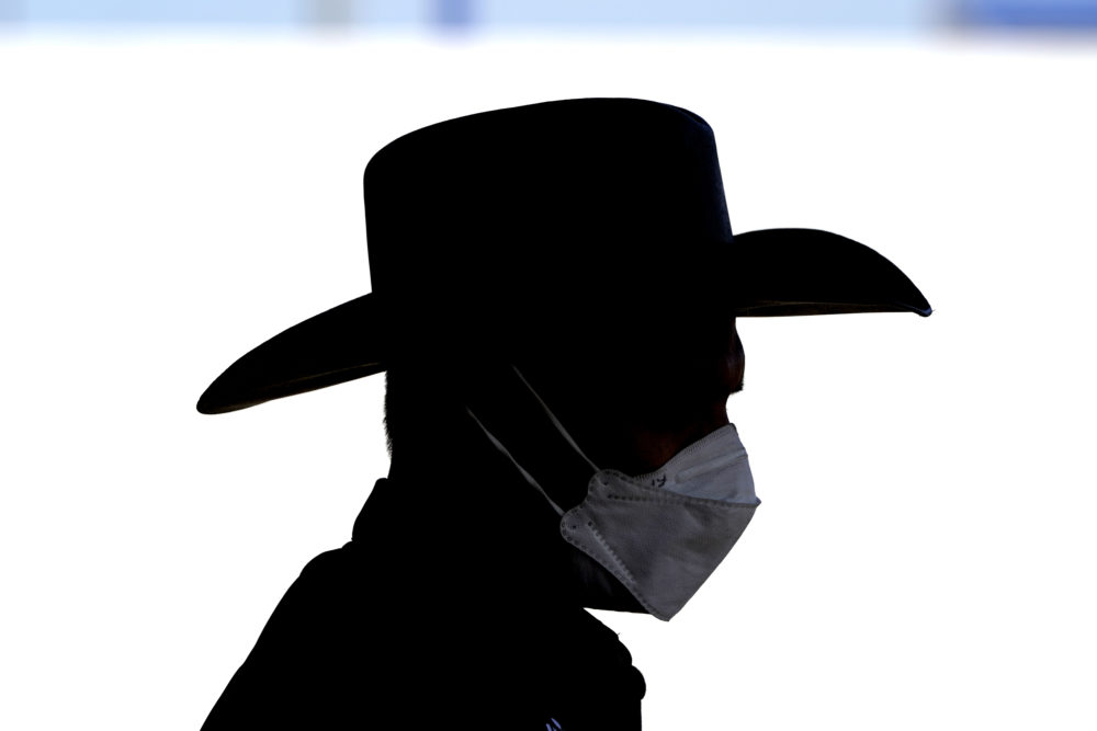 Site director Raheel Khan wears a face mask while helping setup at a newly opened United Memorial Medical Center COVID-19 drive-thru testing site Monday, April 27, 2020, in Houston. (David J. Phillip/AP)