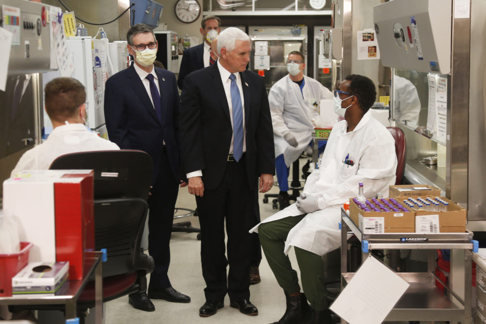 Vice President Mike Pence visits the molecular testing lab at Mayo Clinic Tuesday, April 28, 2020, in Rochester, Minn., where he toured the facilities supporting COVID-19 research and treatment. (Jim Mone/AP Photo)