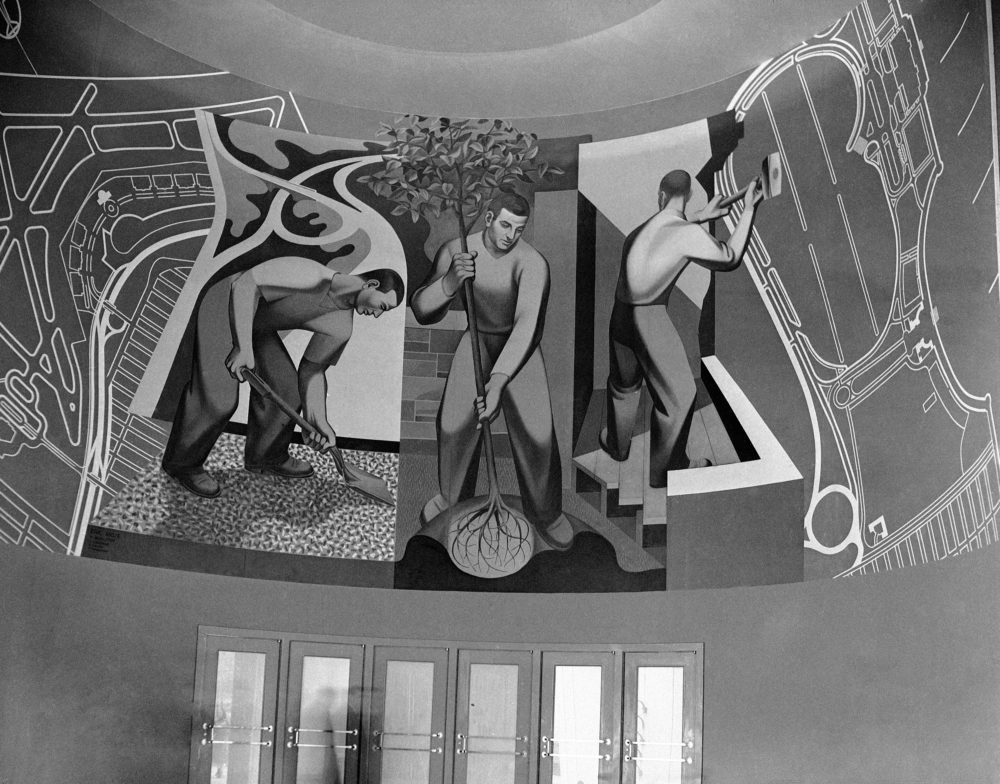 A mural above an entrance shows WPA workers planting trees and building parks at the Worlds Fair in New York on May 3, 1939. (AP)