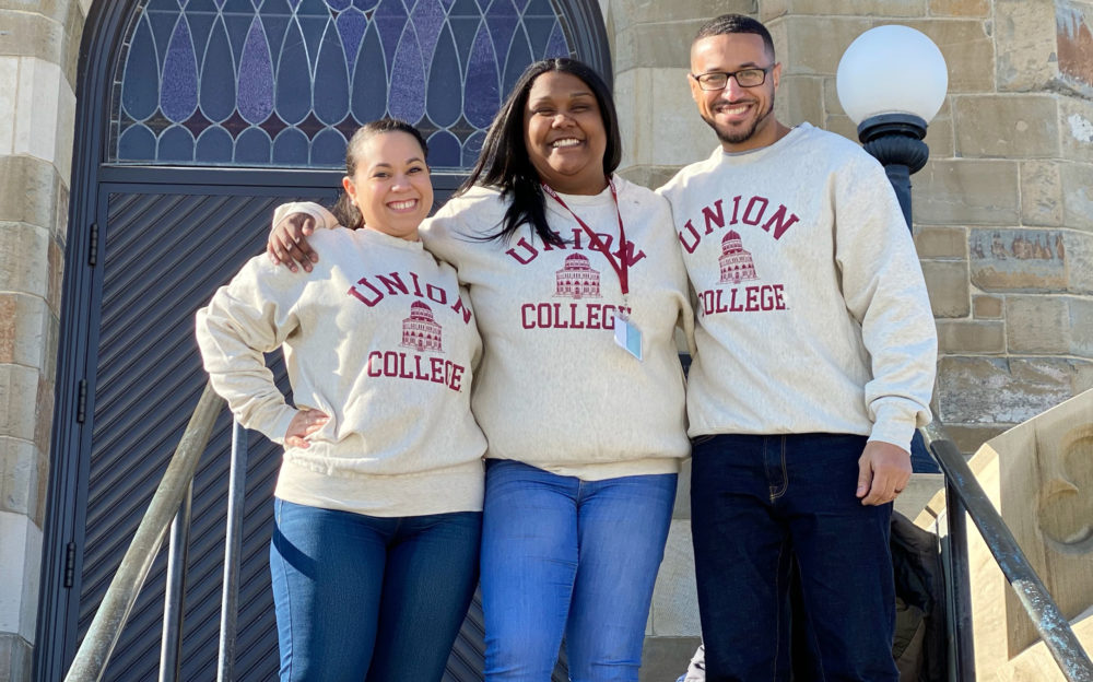 Graduating senior Ashley German (center), with her former teacher Meliza Prieto and Prieto's husband Candinho Gomes at the Union College admitted-students day. (Courtesy Ashley German)