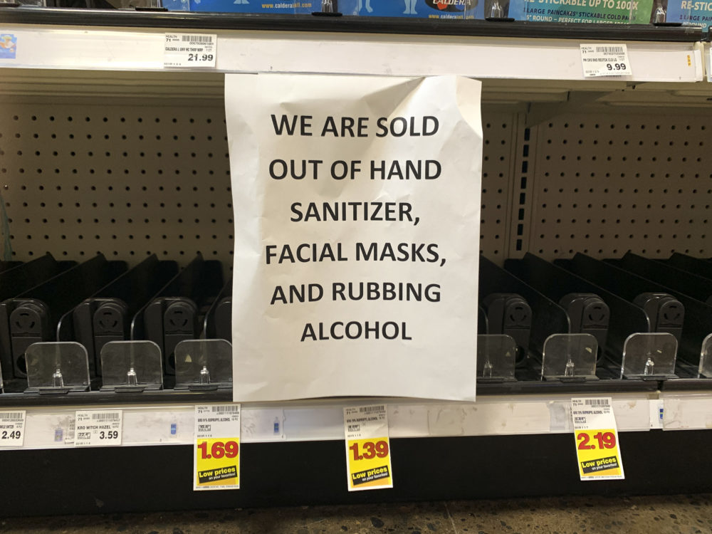 A sign advising out-of-stock sanitizer, facial masks and rubbing alcohol is seen at a store following warnings about COVID-19 in Kirkland, Washington on March 5, 2020. (JASON REDMOND/AFP via Getty Images)