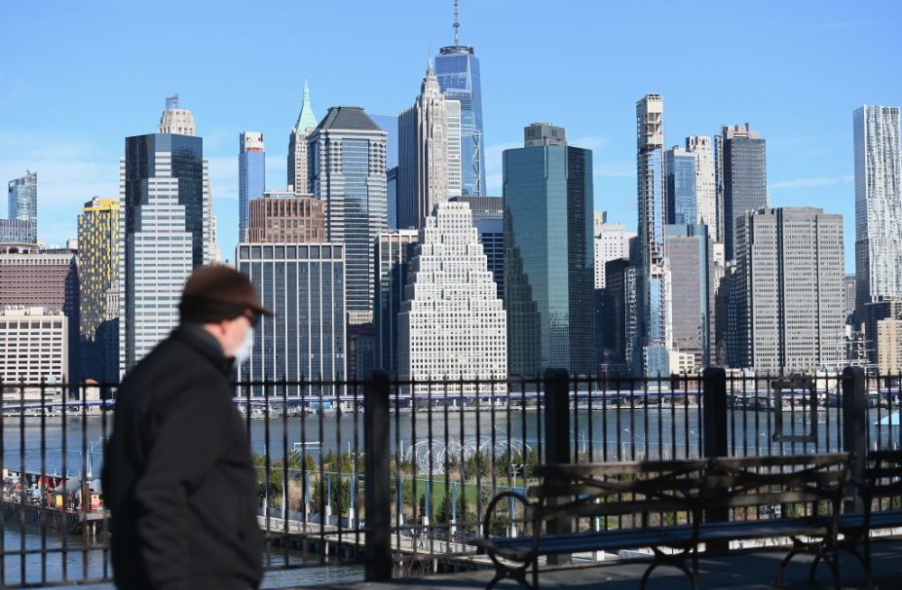A man wearing a face mask takes a walk on the Brooklyn Heights Promenade on March 24, 2020 in New York. (Angela Weiss/AFP/Getty Images)