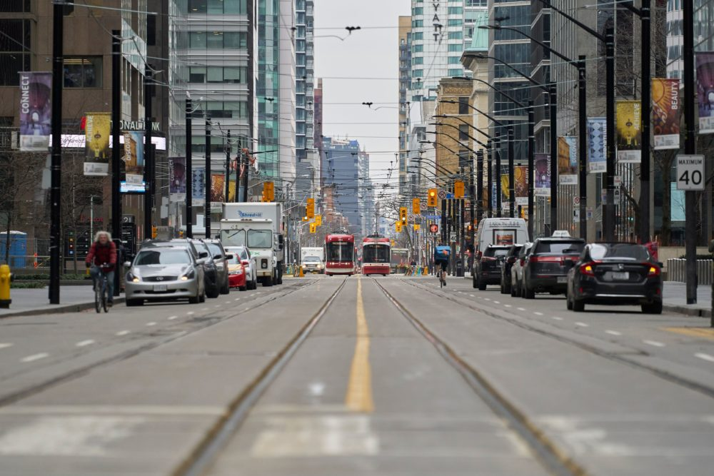 Only a few vehicles line the streets of downtown Toronto, Ontario on March 24, 2020. (GEOFF ROBINS/AFP via Getty Images)
