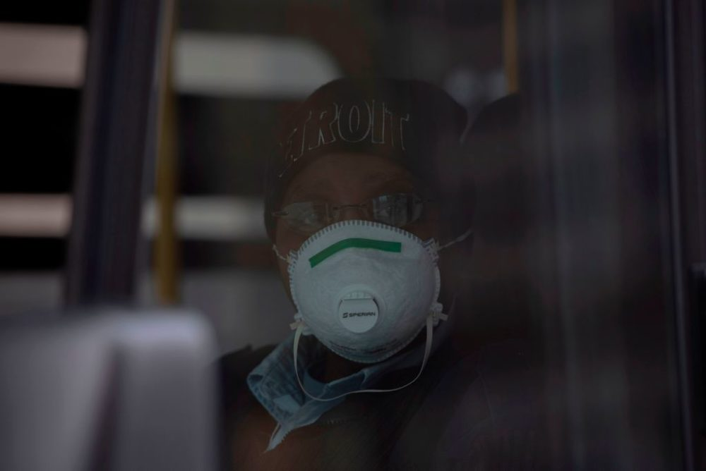 A bus driver for DDOT bus line in Detroit, Michigan, poses for a portrait while wearing her protective mask on March, 24, 2020. (Seth Herald/AFP/Getty Images)