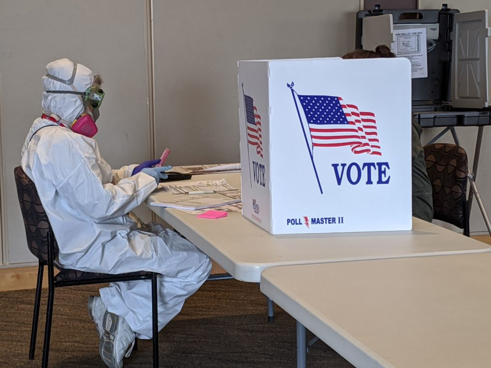 Elections Chief Inspector Mary Magdalen Moser runs a polling location in Kenosha, Wisconsin, in full hazmat gear as the Wisconsin primary kicks off despite the coronavirus pandemics on April 7, 2020. (DEREK R. HENKLE/AFP via Getty Images)