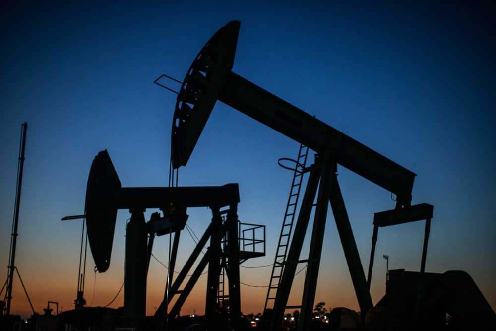 Oil pumpjacks operate at dusk Willow Springs Park in Long Beach, California on April 21, 2020, a day after oil prices dropped to below zero as the oil industry suffers steep falls in benchmark crudes due to the ongoing global coronavirus pandemic. (APU GOMES/AFP via Getty Images)