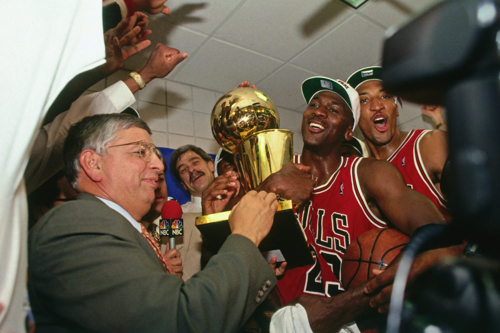 NBA Commissioner David Stern presents Michael Jordan and the Chicago Bulls the championship trophy after the Bulls defeated the Phoenix Suns in Game Six of the 1993 NBA Finals on June 20, 1993. (Photo by Andrew D. Bernstein/NBAE via Getty Images)