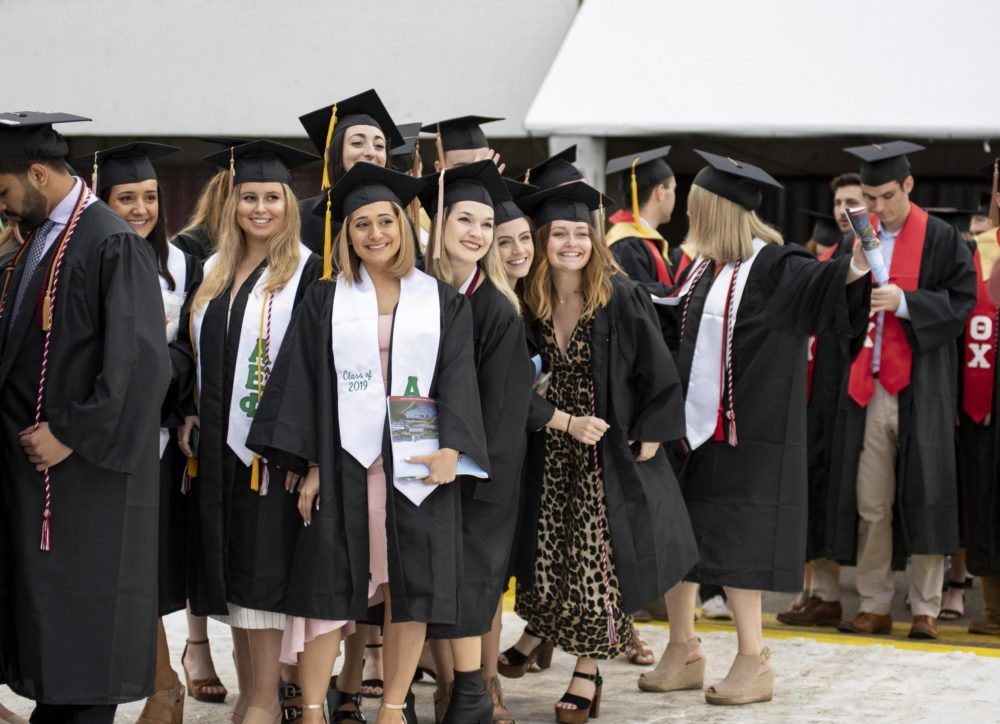 Graduates from UMass Amherst in 2019 line up for commencement exercises. Most May 2020 commencement events in the U.S. were canceled or postponed because of the COVID-19 pandemic.  (Courtesy of UMass Amherst via NEPR)
