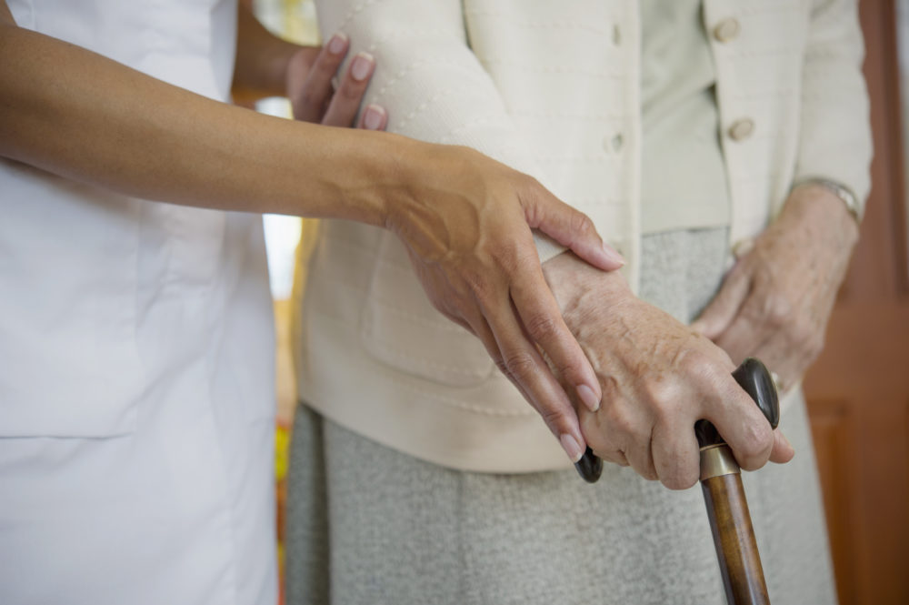 Close up of health care worker helping an older woman walk. (Jacobs Stock Photography Ltd/Getty Images)