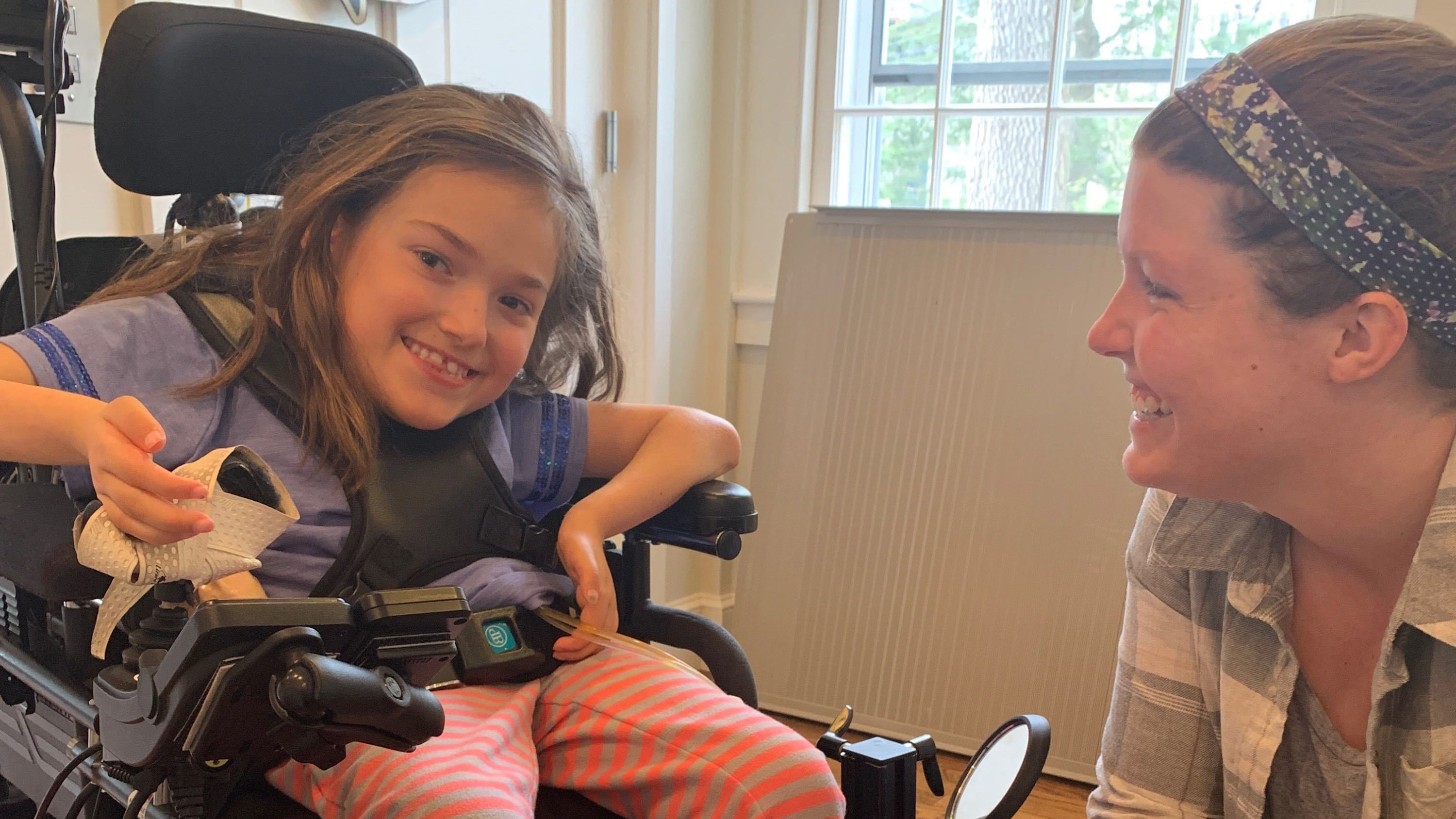 Registered Nurse Kristin Hanifin helps care for 8-year-old Harper Oates in Harper's Brookline home. (Photo courtesy Dawn Oates)