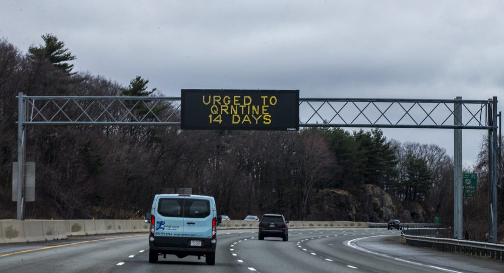 A sign on Route 95 in Waltham urging drivers from outside of Massachusetts to do a 14-day quarantine when arriving for their visit. (Jesse Costa/WBUR)