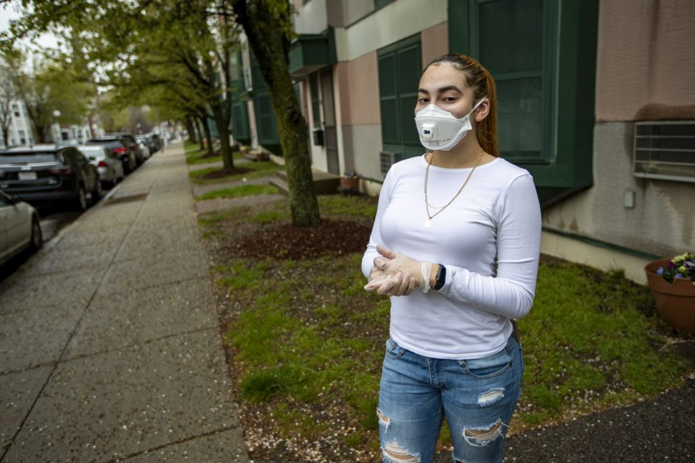 Melany Cardona in the protective personal equipment she wears for work. (Jesse Costa/WBUR)