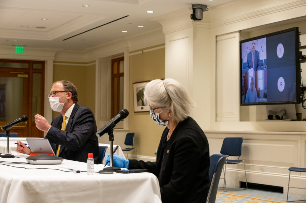 Co-Chairs Sen. Jason Lewis and Rep. Alice Peisch ran Wednesday's Education Committee hearing from a State House function room, while Education Commissioner Jeff Riley and Education Secretary James Peyser appeared virtually on screen. (Sam Doran/State House News Service)