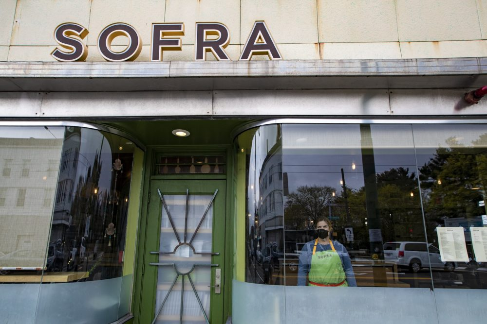2020 James Beard award winner Ana Sortun stands in the window looking out at Sofra in Cambridge. (Jesse Costa/WBUR)