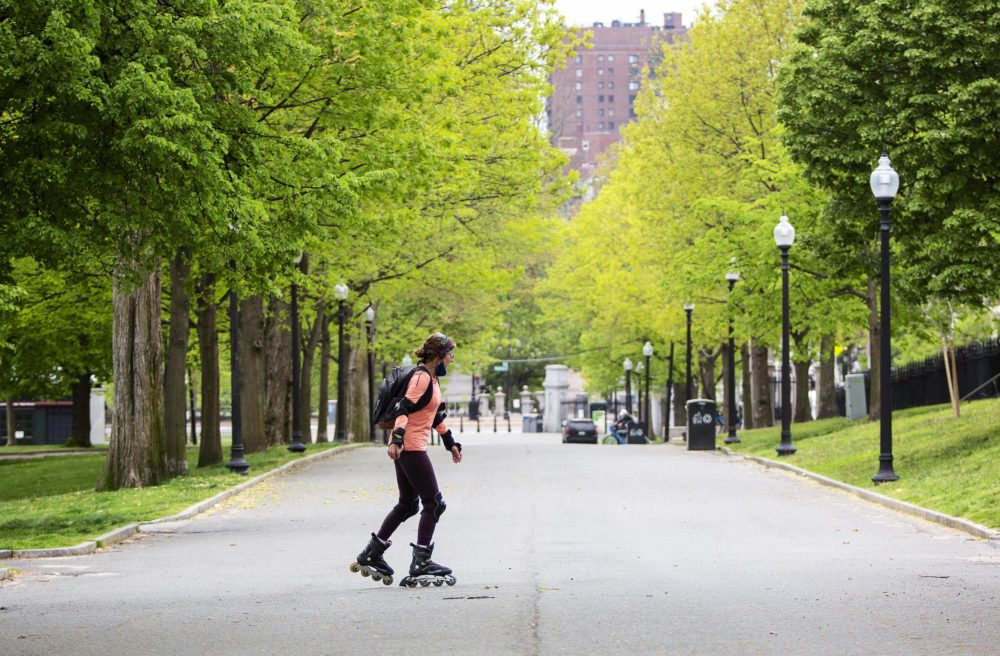 A woman skates down a deserted drive on Boston Common. (Robin Lubbock/WBUR)
