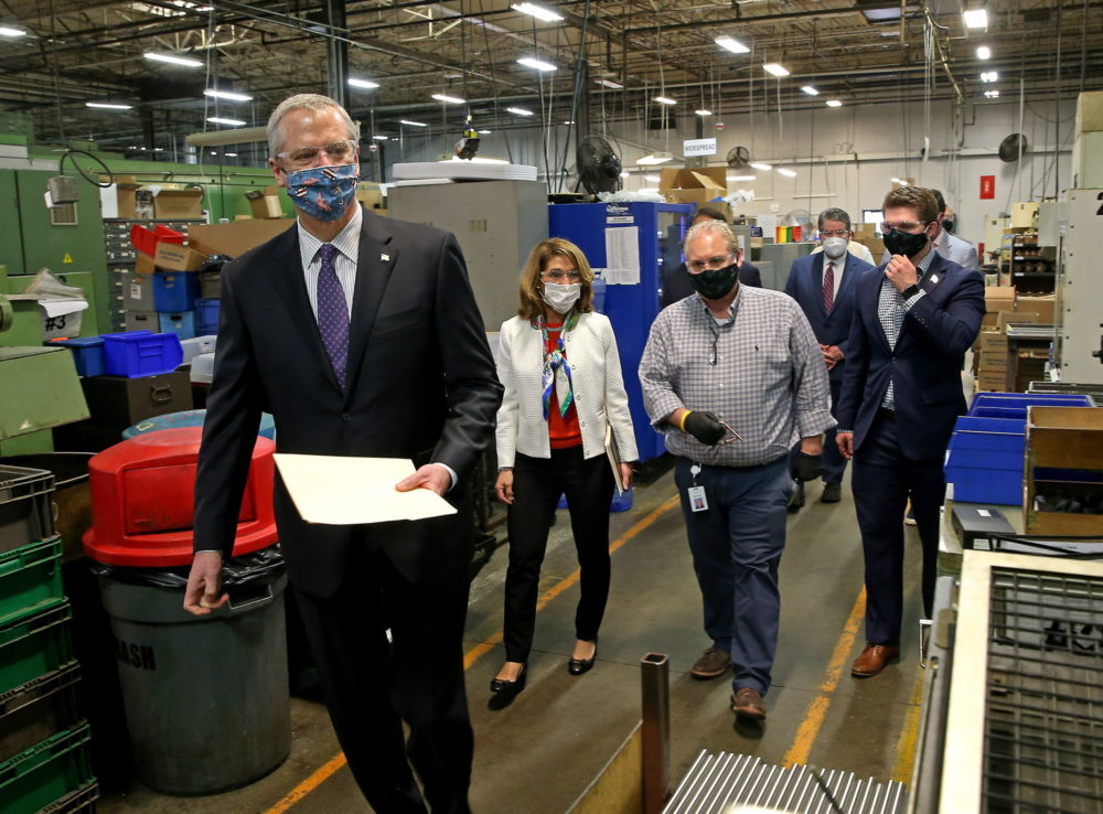 Gov. Charlie Baker and Lt. Gov. Karyn Polito toured Symmons Industries, a plumbing parts manufacturer in Braintree, on Wednesday to see firsthand how a local business is implementing new workplace safety standards. (Matt Stone/Boston Herald/Pool)