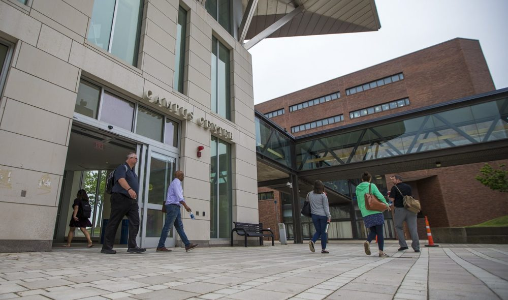 Students and faculty walk out of the Campus Center at UMass Boston, in this 2018 file photo. (Jesse Costa/WBUR)