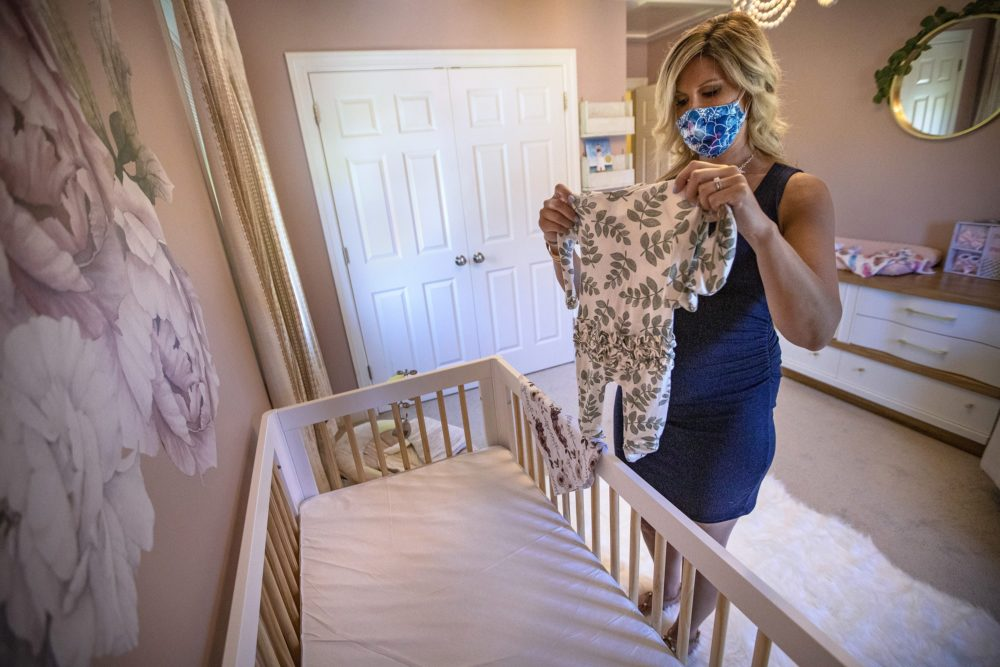 The extended isolation period gave Amanda Joyce and her husband Patrick some extra time to set up the room for a baby girl she's expecting in early August.  (Jesse Costa/WBUR)