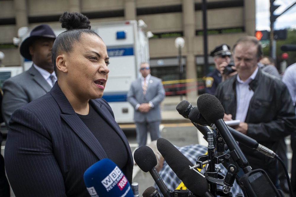 Suffolk County District Attorney Rachael Rollins speaks to the media following a shooting in front of the Colonnade Hotel on Huntington Ave. (Jesse Costa/WBUR)