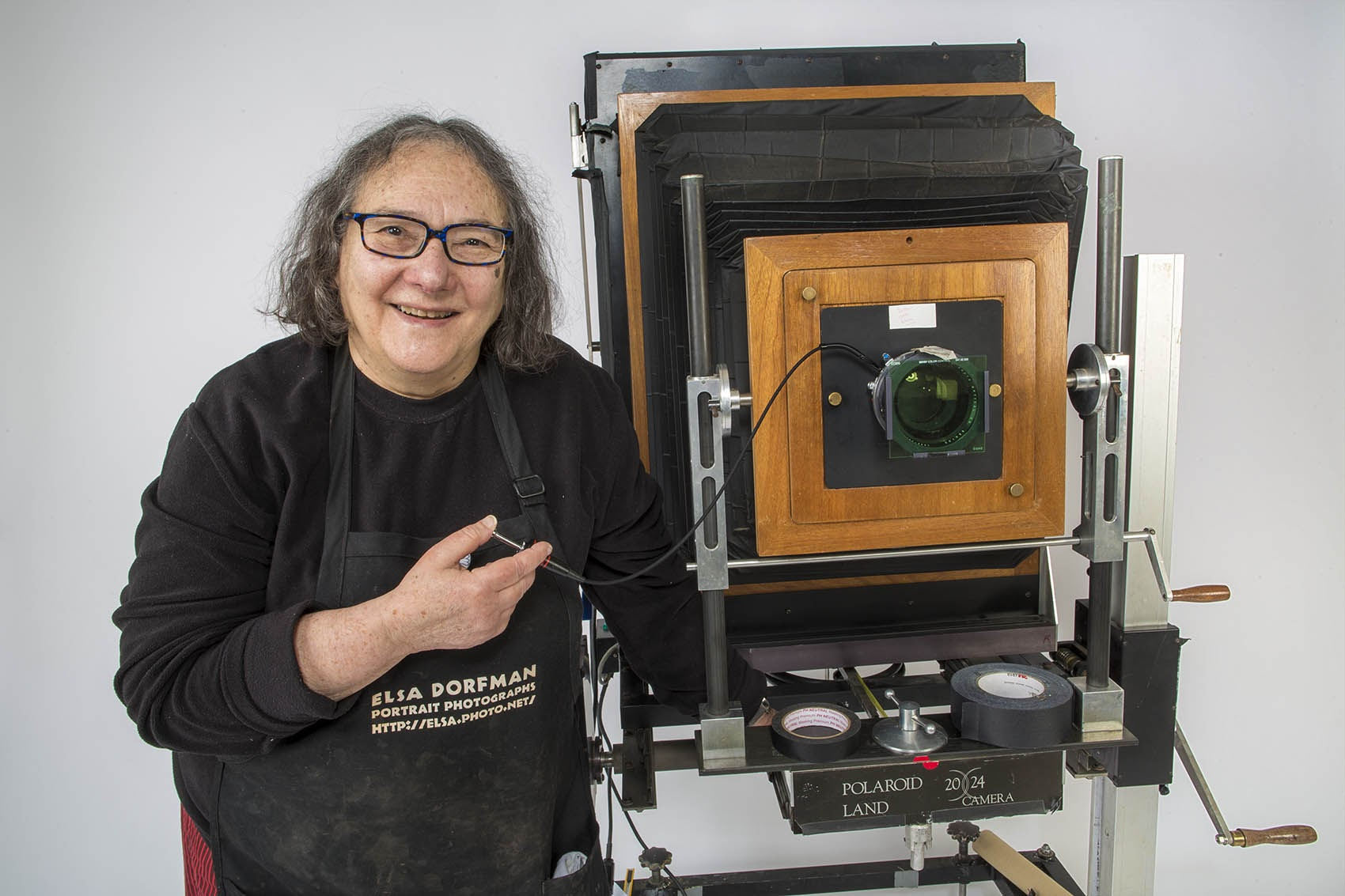 Photographer Elsa Dorfman with her 20x24 Polaroid camera in her studio in 2015. (Jesse Costa/WBUR)