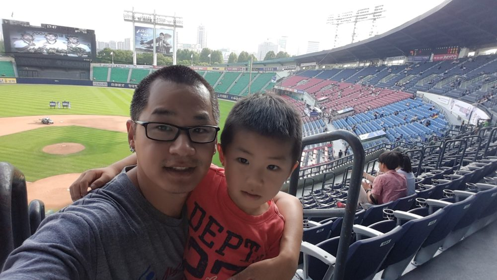 Dan Kurtz, a long time fan of the Korean Baseball Organization, with his oldest son at Jamsil Stadium in Seoul, South in 2015. (Dan Kurtz)