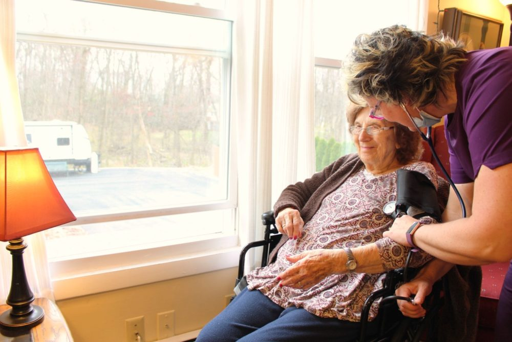 A nurse helps a patient at  Shady Oaks Assisted Living. (Courtesy of Tyson Belanger)