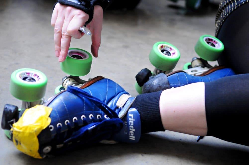 A skater adjusts her Riedell Skates. (Dawn Villella/AP)