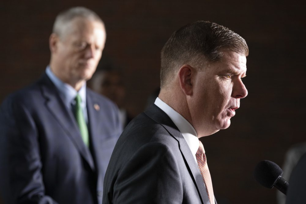 Boston Mayor Marty Walsh talks about the postponement of the Boston Marathon as Gov. Charlie Baker, left, looks on, during a news conference. (Michael Dwyer/AP)