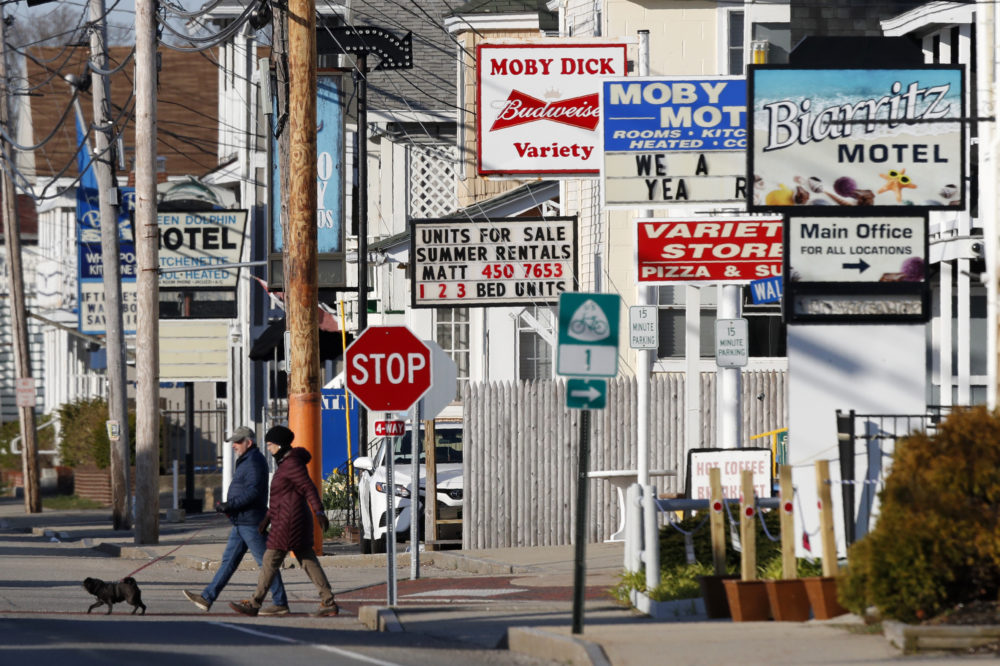 A couple walks by a row of closed motels, Wednesday, April 29, 2020, in Old Orchard Beach, Maine. Gov. Janet Mills on Tuesday announced tentatives plans to allow for lodging, campgrounds and the reopening of bars on July 1.  (Robert F. Bukaty/AP)