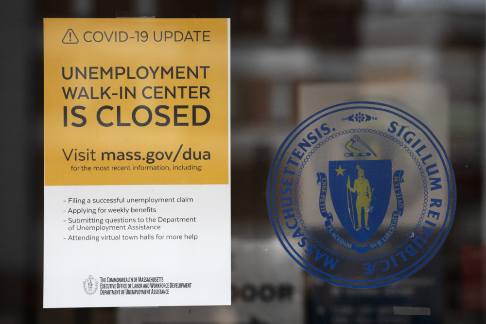 A sign announces the closure of the Massachusetts Unemployment Office, May 9, 2020, in Boston. (Michael Dwyer/AP)