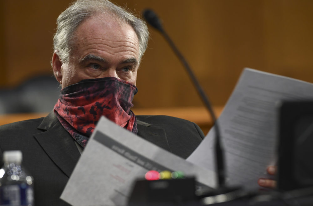 Sen. Tim Kaine, D-Va., listens to testimony before the Senate Committee for Health, Education, Labor, and Pensions hearing, Tuesday, May 12, 2020 on Capitol Hill in Washington.  (Toni L. Sandys/The Washington Post via AP Pool)