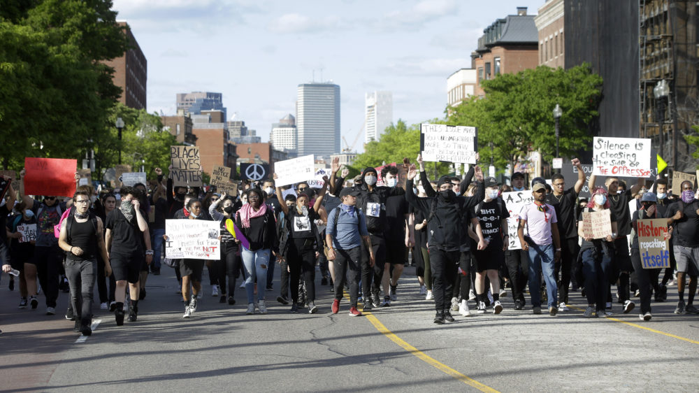 Protesters demonstrate Sunday, May 31, 2020, in Boston, over the death of George Floyd, a black man who was in police custody in Minneapolis. (Steven Senne/AP Photo)