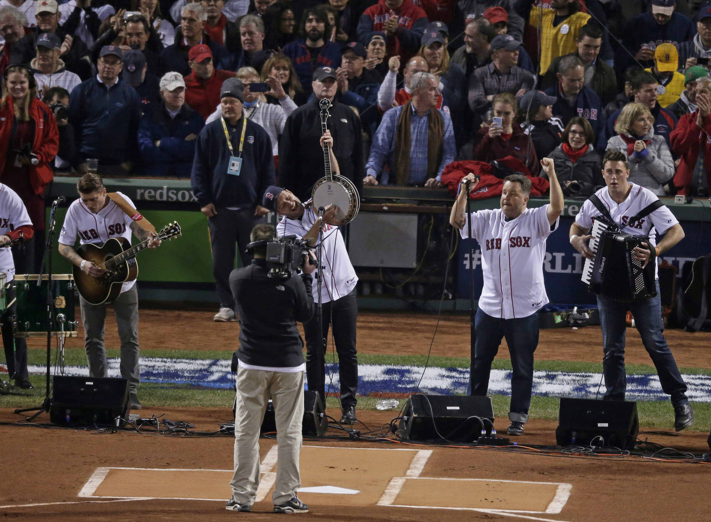 Dropkick Murphys perform before Game 6 of baseball's World Series between the Boston Red Sox and the St. Louis Cardinals Wednesday, Oct. 30, 2013, in Boston. (Charlie Riedel/AP)