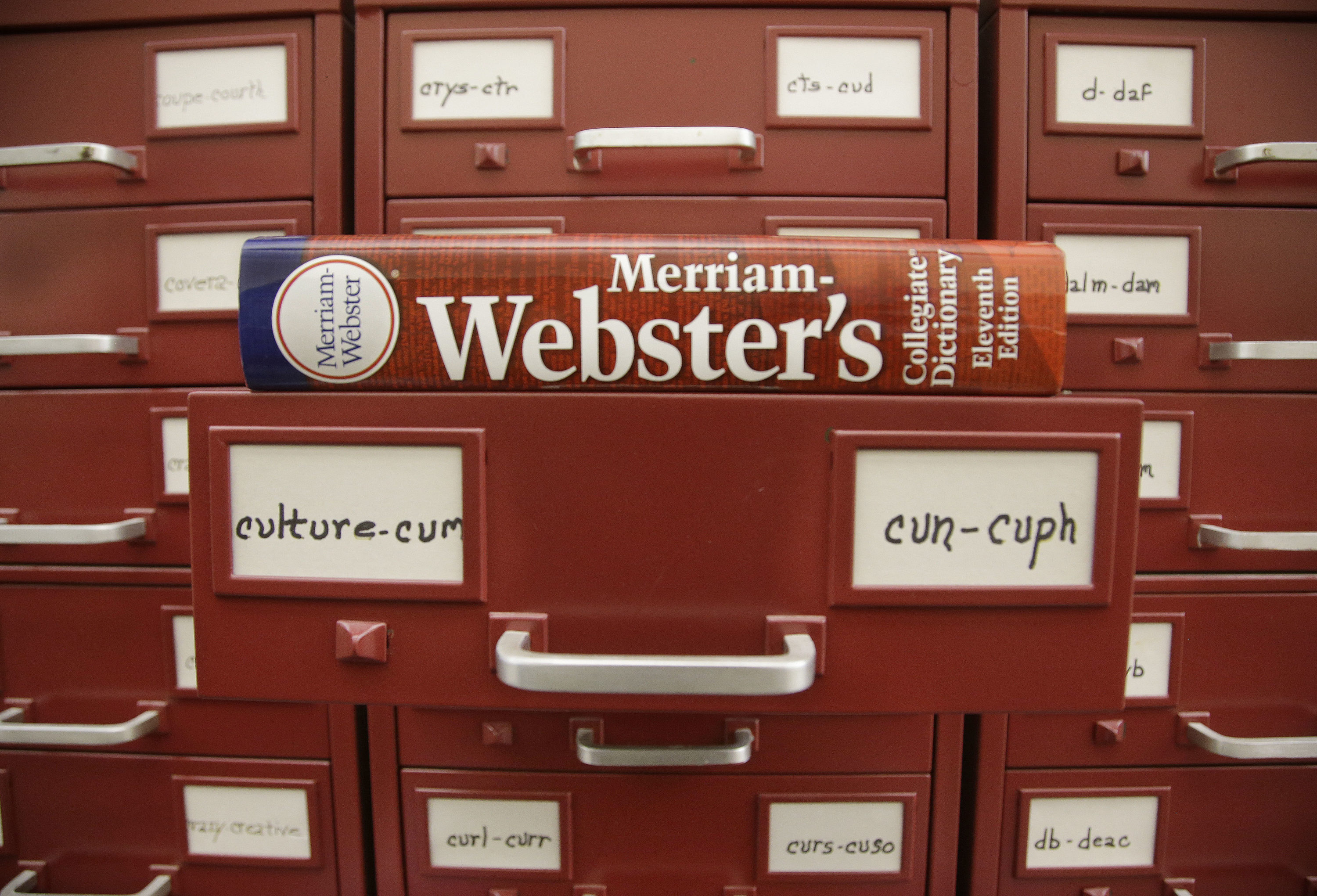 "A Merriam-Webster dictionary sits atop their citation files for the 2014 word of the year, ""culture,"" at the dictionary publisher's offices in Springfield, Massachusetts. (Stephan Savoia/AP)"