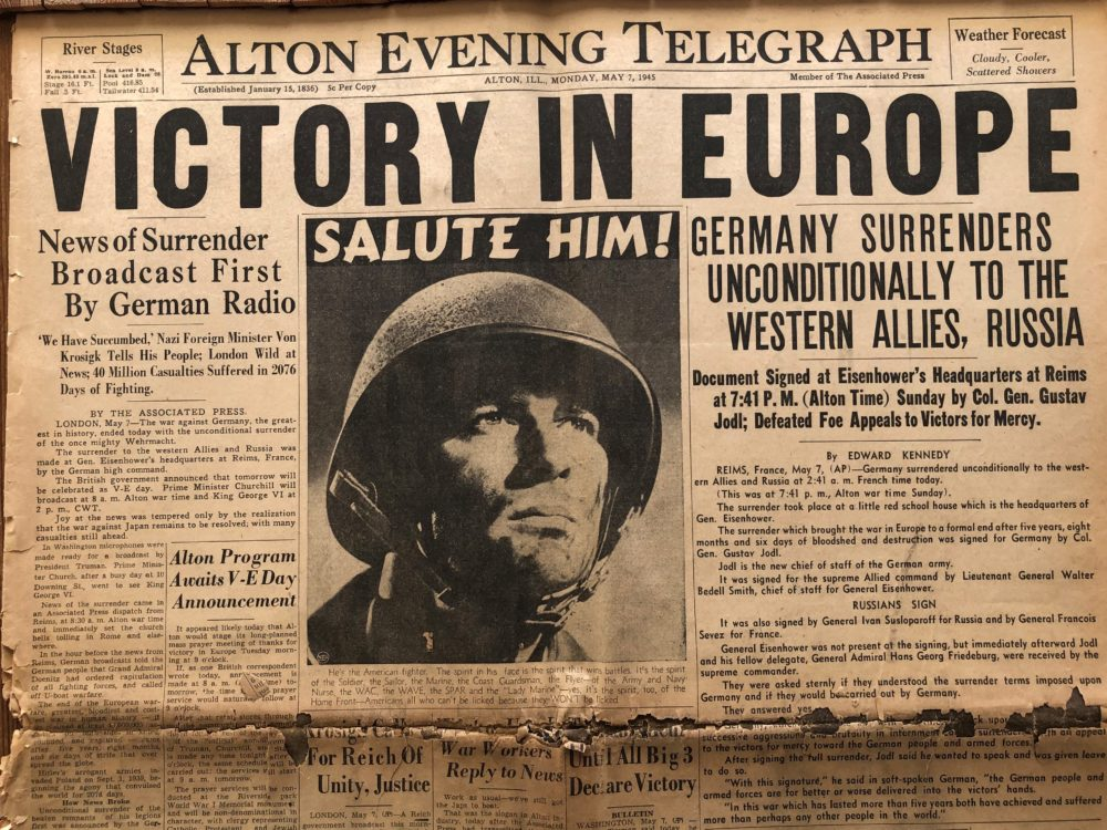 The Alton Evening Telegraph reporting the news of Germany's surrender.