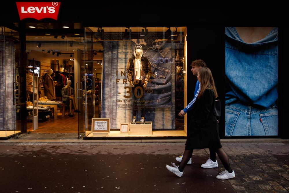 People walk in front of LEVI'S shop in the city of Caen, northwestern of France, on Nov. 29, 2019. (Sameer Al-Doumy/AFP via Getty Images)