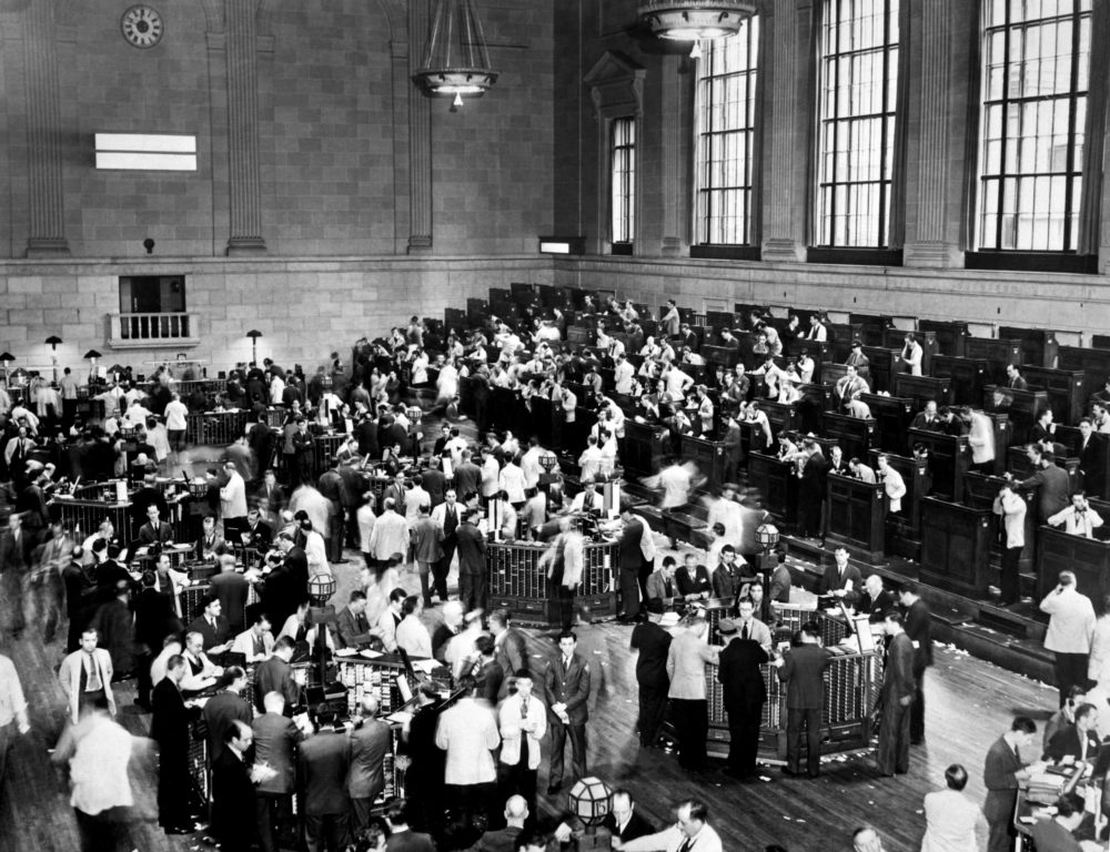 Traders rush, 1929, October in Wall Street as New York Stock Exchange crashed sparking a run on banks that spread across the country. (Photo via Getty Images)